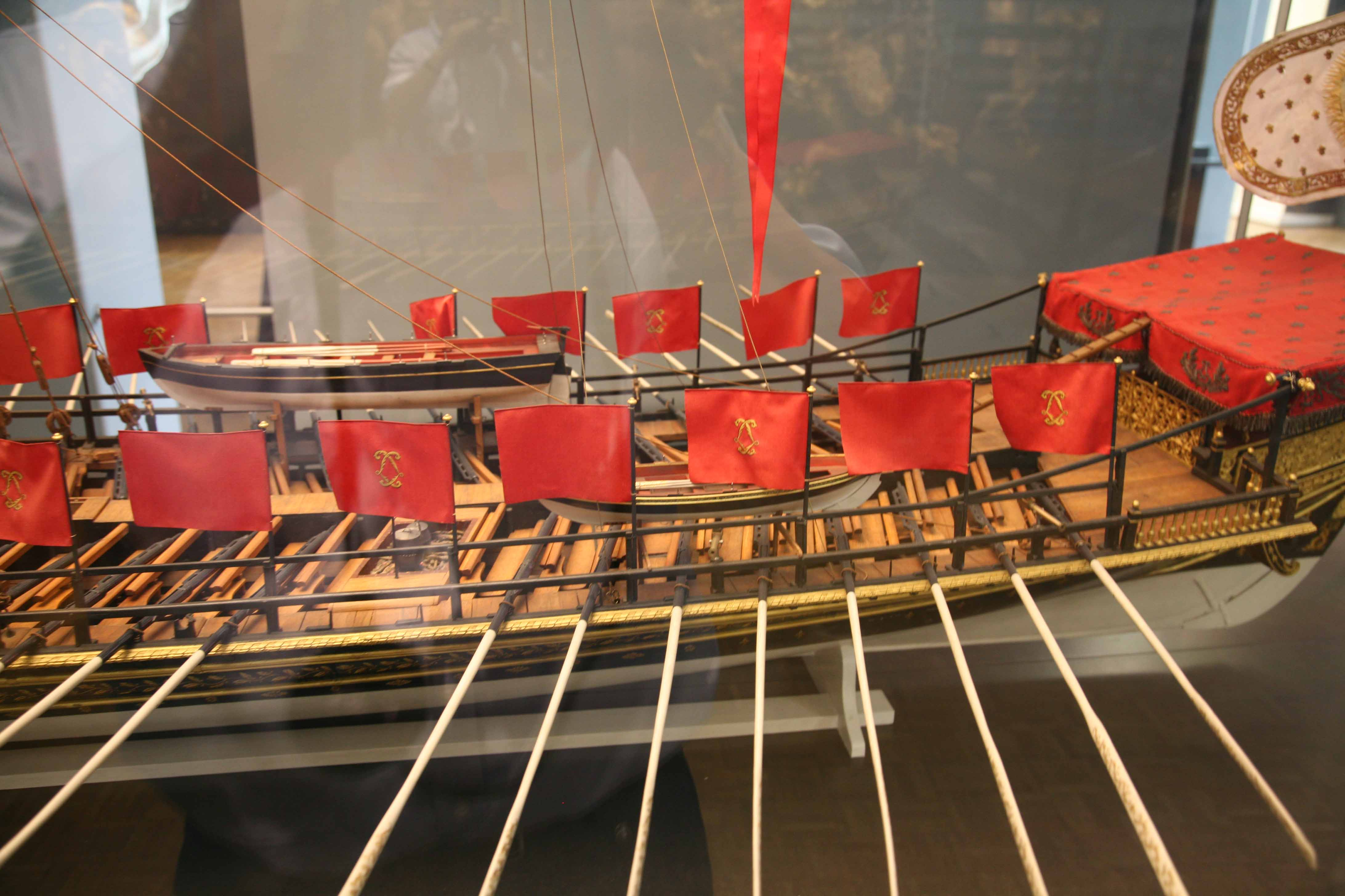 Photos of stern decoration and model of galley Réale de France, 1664